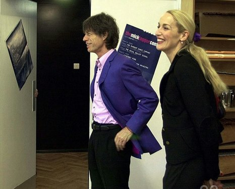 Mick Jagger, alongside his wife Jerry Hall in the New Music Studio at Dartford Grammar School, Kent