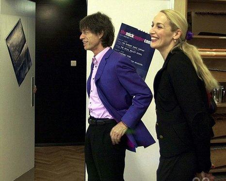 Mick Jagger, alongside his wife Jerry Hall in the New Music Studio at Dartford Grammar School, Kent