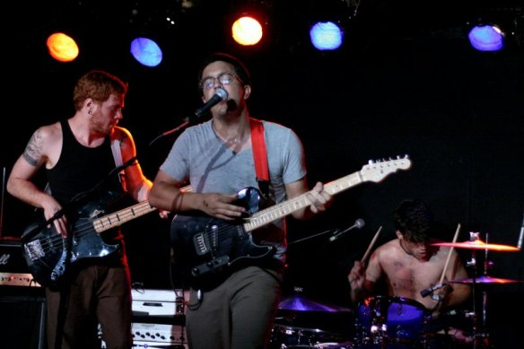 Mike Robinson (bass), Kenny Florence (guitar), and Adam Baker (drums) playing as Sunfold at Mercury Lounge on July 26, 2008